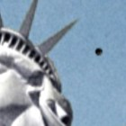UFO Appears In The Sky Above Statue Of Liberty